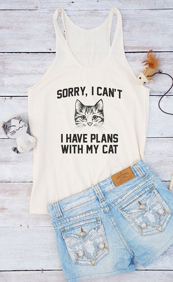 You can find more item of this design here https://www.etsy.com/shop/MoodCatz?ref=si_shop&search_query=cat+plans ITEM FEATURES • 100% semi-combed cotton • Racerback • A-line body • Double needle stitch neckline, armholes and curve hem …………………………………. Size S Chest: 31-32 inches pit to pit Length: 27 inches shoulder to bottom Size M Chest: 33-34 inches pit to pit Length: 27 inches shoulder to bottom Size L Chest: 35-36 inches pit to pit Length: 28 inches s...