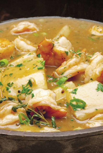 Emeril's Cajun Shrimp Stew - vegetable oil - flour - onion - minced garlic - shrimp or fish stock - bay leaves - cayenne - fresh thyme leaves - kosher salt - baking potatoes or other root vegetables - shrimp - green onion - fresh parsley - rice - Scrumpdillyicious