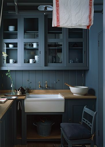 Dark blue kitchen by plain english in blue room ideas on house dark cupboards with glass panels make for a beautiful combination in this kitchen by plain