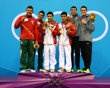 (L-R) Silver medalists German Sanchez Sanchez and Ivan Garcia Navarro of Mexico, gold medalists Yuan Cao and Yanquan Zhang of China and bronze medalists Nicholas Mccrory and David Boudia of the United States celebrate celebrate on the podium with their medals during the medal cermony for the Men's Synchronised 10m Platform Diving on Day 3 of the London 2012 Olympic Games at the Aquatics Centre on July 30, 2012. http://www.PaulFDavis.com/success-speaker (info@PaulFDavis.com)