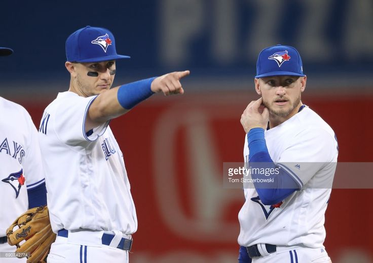 Troy Tulowitzki #2 of the Toronto Blue Jays and Josh Donaldson #20 during a break in the action during MLB game action against the Cincinnati Reds at Rogers Centre on May 30, 2017 in Toronto, Canada.