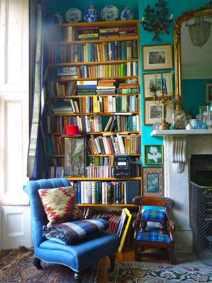 Absolute fan of overstuffed bookshelves :) This image just makes me happy as an avid reader. This space was meant to be read in.: