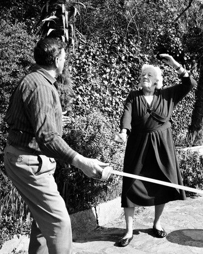 Margaret Rutherford practicing fencing for her swordfighting scene as Miss Marple in Murder Ahoy.