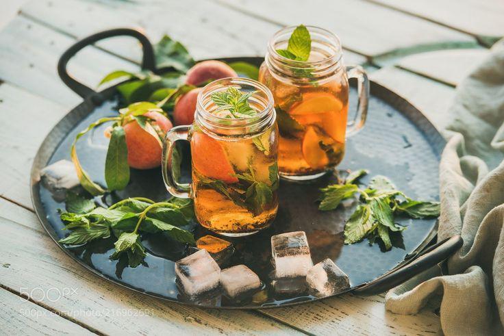 Summer refreshing cold peach ice tea on rustic wooden table (Anna Ivanova / Alanya / Turkey) #NIKON D610 #food #photo #delicious