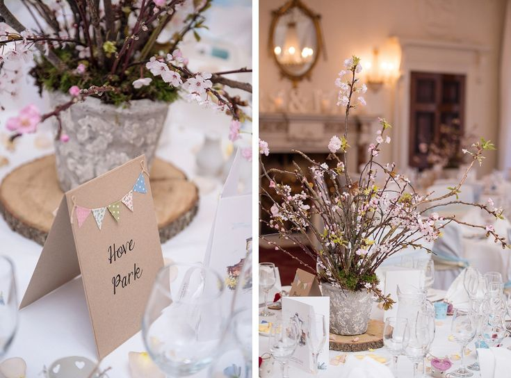 buxted park hotel spring wedding. blossom branch table centrepieces with wood slice from pollen flowers of brighton. www.pollenflowers.co.uk