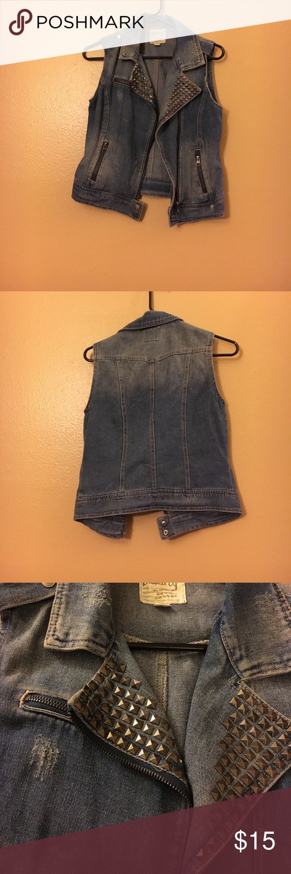 Distressed studded denim vest Distressed studded denim vest! Light wear no stains and all tears visible were there when purchased! Very cute layering vest! Has pockets also ❤️ Jackets & Coats Vests
