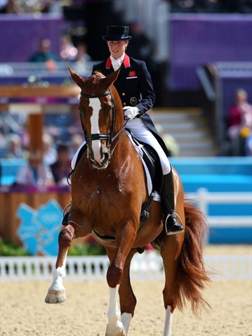 Laura Bechtolsheimer of Great Britain riding Mistral Hojris competes in the Dressage Grand Prix on Day 6 of the London 2012 Olympic Games at Greenwich Park.