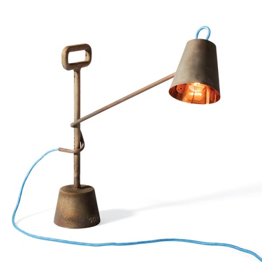 Both sturdy and whimsical, the copper lamp is a tongue-in-cheek way to collect a full ten kilograms of metal deposits as a long-term investment.    Read more: http://www.dwell.com/products/copper-lamp-10kg.html#ixzz1sK7Kv0VB
