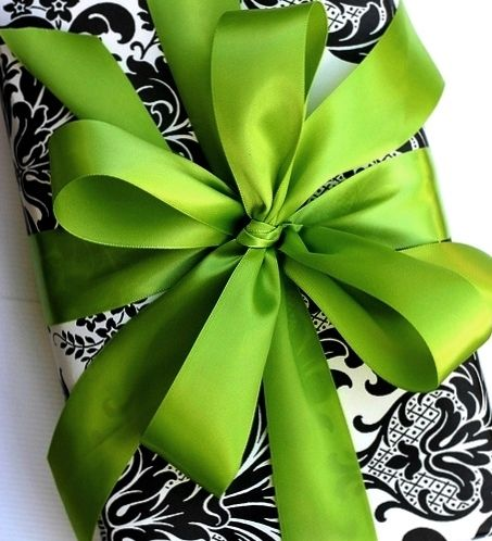 Just shows that gift wrapping of this color can still end up eye-popping and stand out. Use any color bright ribbon with black/white. You can even use white wrapping paper, black lace, then the ribbon...... just a thought.