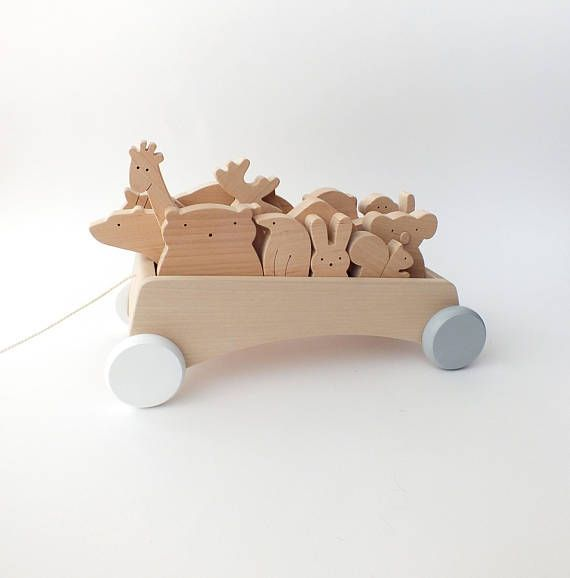 Wooden Pull Toy Wagon  Original designed wooden pull toy wagon enhances active play and supports the development of motor skills. Age suitability: 2 – 5 years  Toy size: 27 x 14,5 x 9 cm (10.5 x 5.7 x 3.5 in)  !!! *This listing is only for the wagon.* Animals are not included.  You can buy the animals here https://www.etsy.com/shop/mielasiela?ref=listing-shop2-all-items-count&section_id=11006195  The wagon is designed to carry our wooden animals. There can fi...