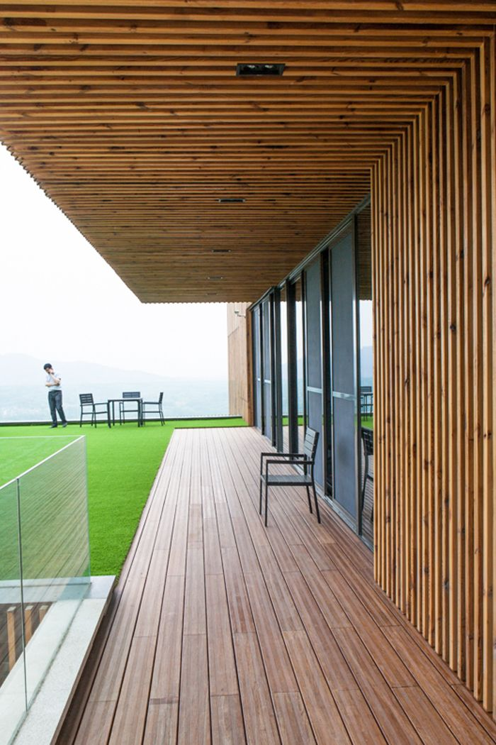 Spa-Clubhouse at Garden Valley - Mei Jie Mountain Hotspring resort in Liyang, China. by AchterboschZantman architecten #walkway #slats #wood #overhang #bamboo #terrace