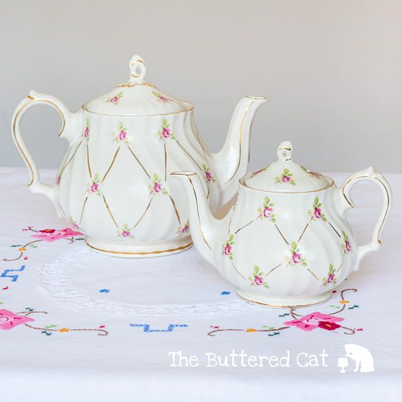 Pretty pair of Sadler teapots pink ditsy rose on cream