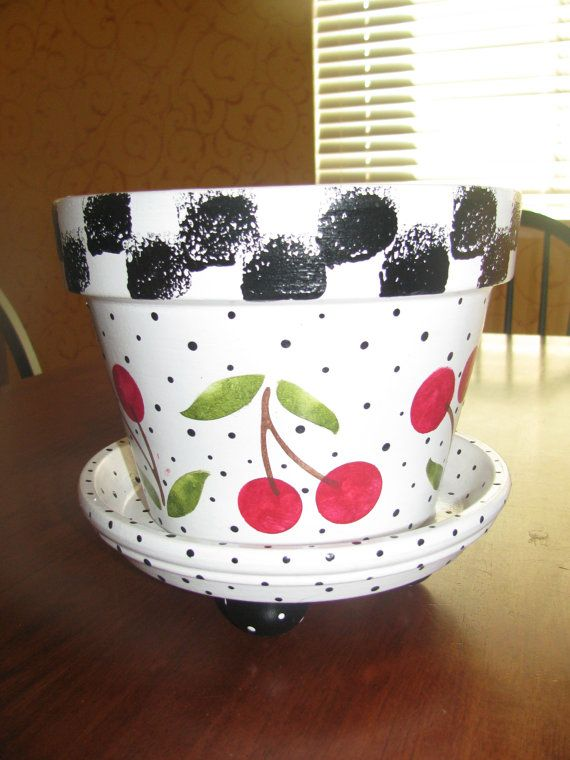 This 8 inch flower pot has cherries all around pot.. It is painted in beautiful bright colors and has a water proof varnish inside and out. The drainage