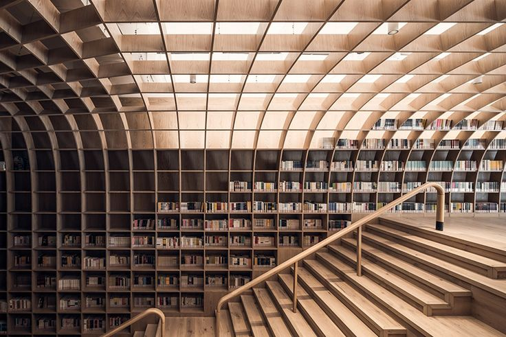 shanghai's onepark residential community in gubei presents its latest amenity, wutopia lab's 'underground forest' — a multipurpose library center.