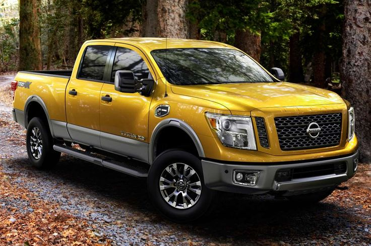 2016 Nissan Titan XD Pro 4X Front Side View Leaves - Provided by Automobile