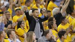 Golden State Warriors' Stephen Curry reacts as Houston Rockets' Dwight Howard fouls out in 4th quarter during Warriors' 115-106 win in Game 2 of 1st round of NBA Playoffs at Oracle Arena in Oakland, Calif., on Monday, April 18, 2016.