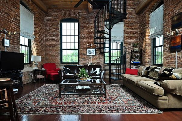 Exposed brick walls and spiral staircase. Lofts at Mills Mill