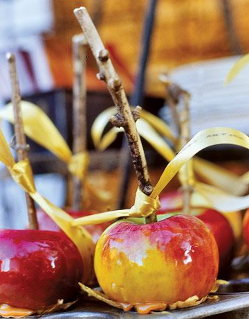 Toffee Apples on twigs for a rustic wedding treat...