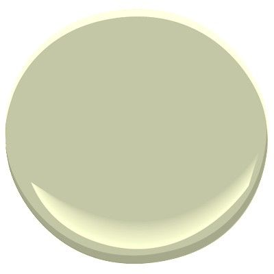 Benjamin Moore Mesquite, flattering light moss green without much yellow, works well in dark rooms with incandescents
