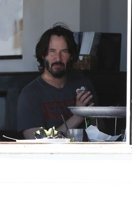 Keanu Dines with Friends 21/Jul/2016 Keanu Reeves, looked to have no worries in the world as he enjoyed dining with his friends seaside at 'Sunset Restaurant'.