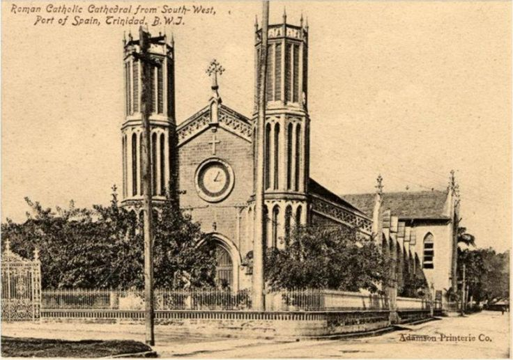 CATHEDRAL OF THE IMMACULATE CONCEPTION, MARINE SQUARE, PORT OF SPAIN CIRCA 1907 (note the foliage surrounding the building which was planted in the 1890s and has now been removed)    In 1784, the capital of Spanish Trinidad officially was transferred from San Jose de Oruna (St. Joseph) to Puerta de los Hispanoles (Port of Spain). Since the population was almost entirely Roman Catholic, a small wooden chapel was erected on a piece of land now known as Columbus Square