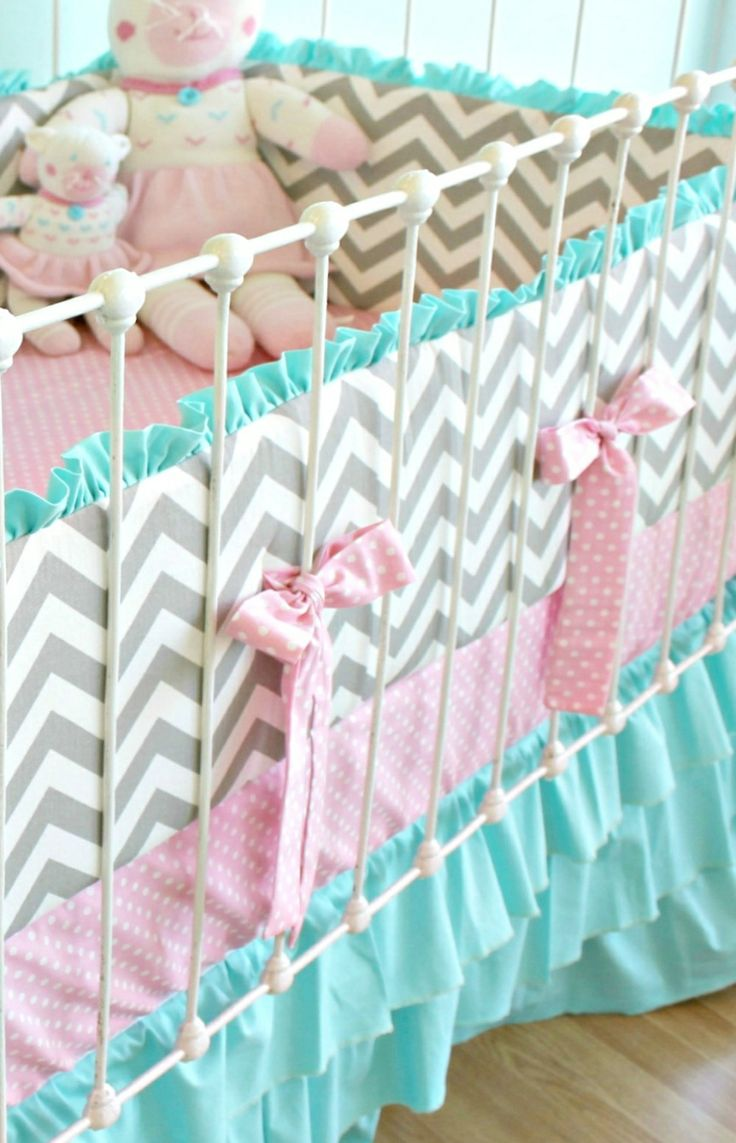 White and Grey Chevron with Pink accents and Blue Ruffles, what a great combination for a baby girl's nursery