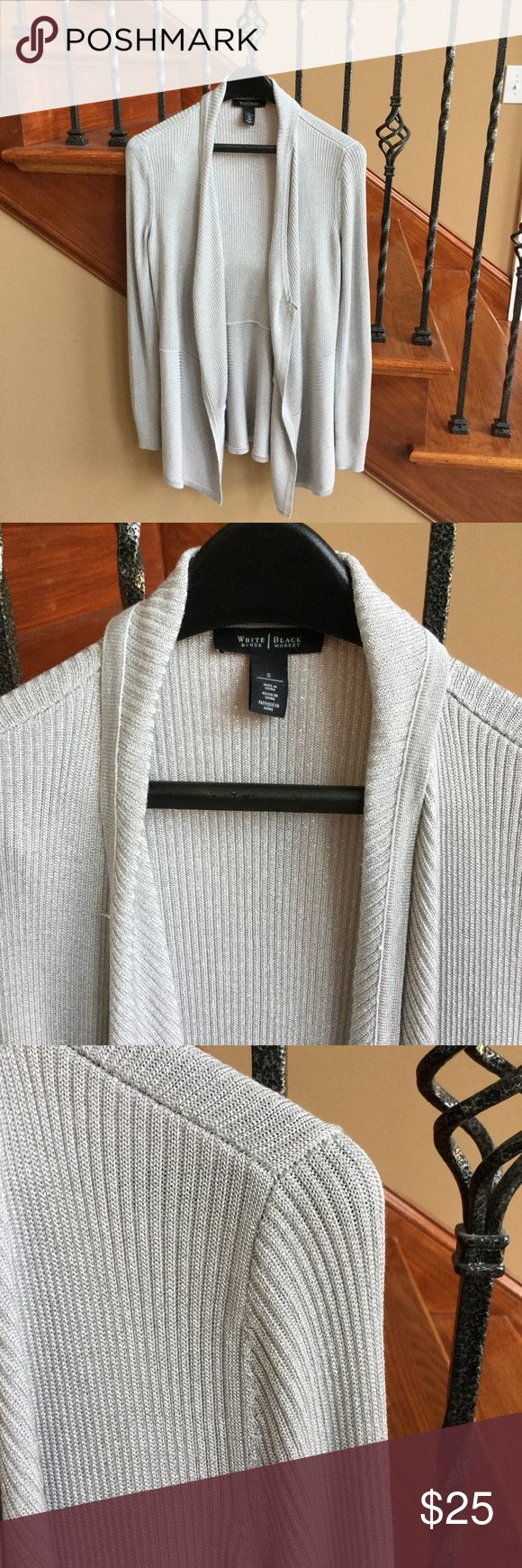 White House Black Market Silver cardigan EUC Silver cardigan from WHBM has longer length and soft open front. Subtle silver to add a little flash to your everyday look or dress up for evening. White House Black Market Sweaters Cardigans