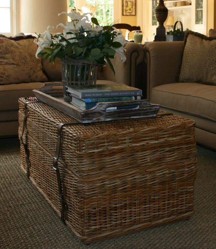 A wicker trunk from Williams Sonoma Home replaces the formal coffee table. ( BIG Pic )