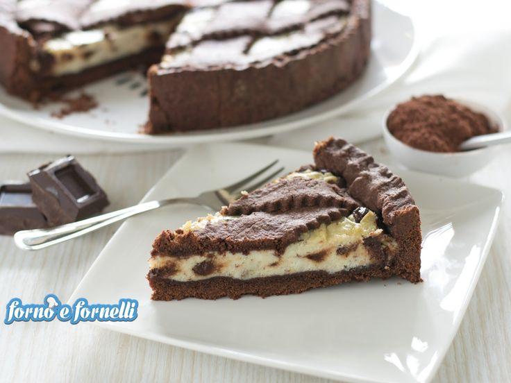 La Crostata al cioccolato con crema di ricotta è un dolce semplice da preparare e molto molto goloso: riuscirete a resistere ad una fetta?