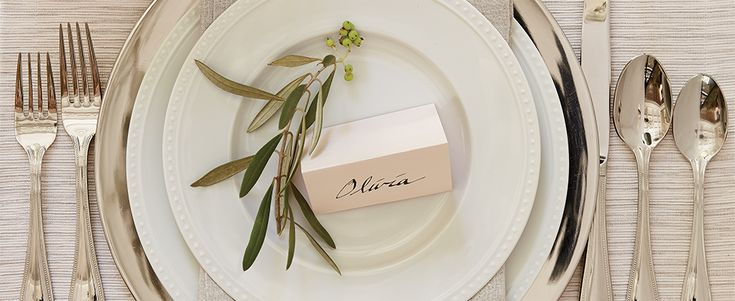 Elegant place setting with charger plate and flatware