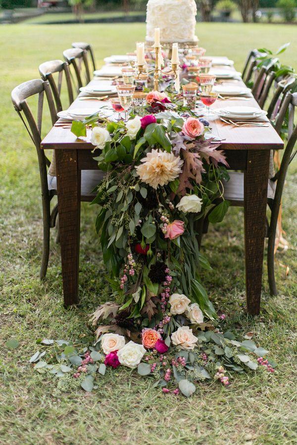 cascading floral runner - photo by J.Ashley Photography http://ruffledblog.com/wedding-elegance-at-bisham-manor