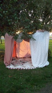 Clothespin sheets to to the trampoline to give the girls a little more privacy from the neighbors during their sleepover.