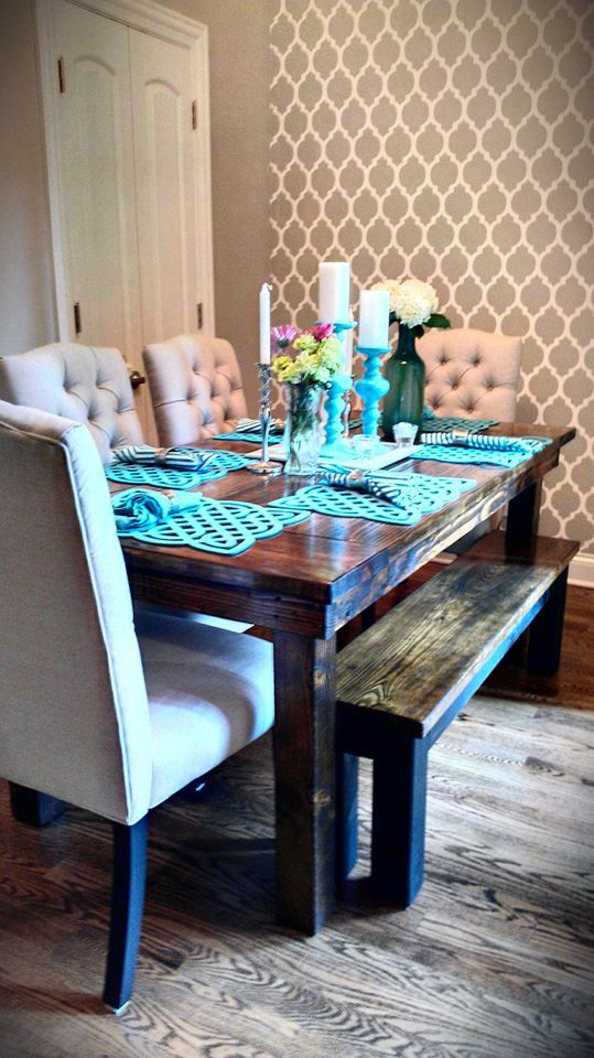All vintage-distressed Farmhouse table from James+James. Paired with beautiful ivory fabric chairs, bright blue dining setting and wood floors.
