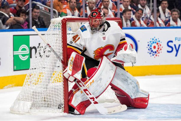 Calgary Flames Goalie Mike Smith watches the play in the corner on a power play during the Edmonton Oilers game versus the Calgary Flames at Rogers...