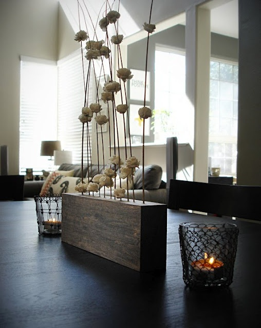 A new centerpiece for the dining room table. This was a simple DIY - just take a block of wood, stain if desired, then drill holes in the top with a hand drill. Easy. I added some more willow branches.