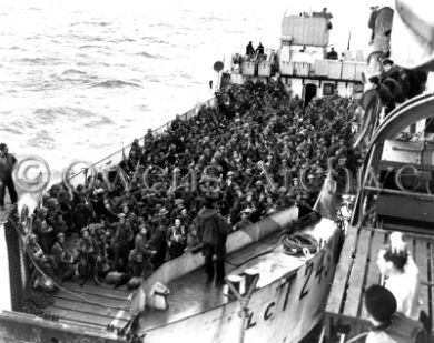 This is another picture from d-day and is of the troops on the boat waiting to arrive in Normandy. It shows how many people wanted to help in the war and that they are ready to fight and help the allies. It demonstrates the Canadian involvement in the war and their readiness to help and prove their courage. This picture is a credible source because it can give a lot of information about d-day and the Canadian involvement.