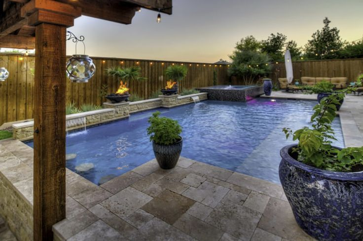 A beautifully designed backyard from Riverbend Sandler will have you living in the lap pool of luxury all year long.
