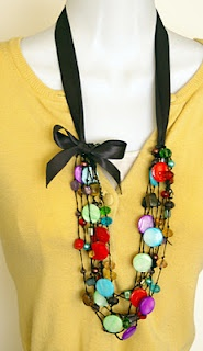 Using ribbon to add a new look to an old necklace. Awesomeness! ;)