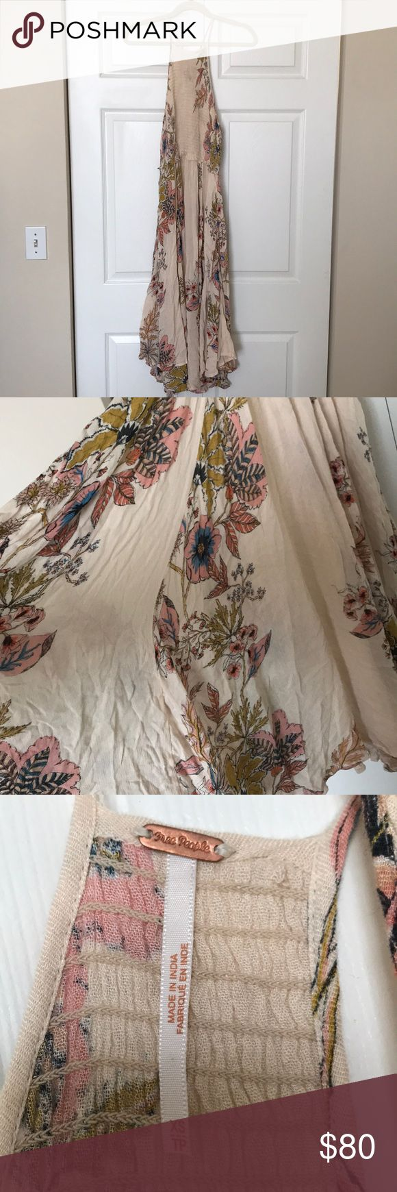 "Free People Pale pink floral midi dress Free people  ""Tea length"" or midi  Pale pink/nude with mustard, coral and blue floral print Size XS (4-6) Never worn Free People Dresses Midi"