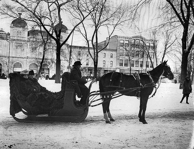 A. W. Speir and wife in sleigh, Phillip's Square, Montreal, 1907, via Flickr.