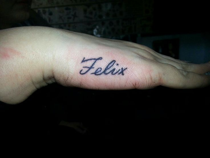 Name tattoo on hand