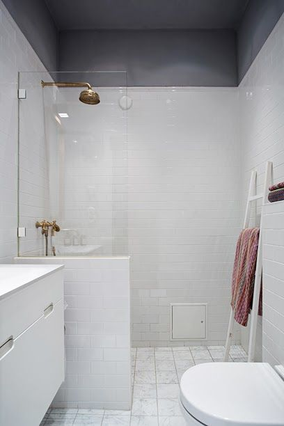 All white- Mexican-style shower - small wall to separate space, but still very open. Love the darker ceiling too.