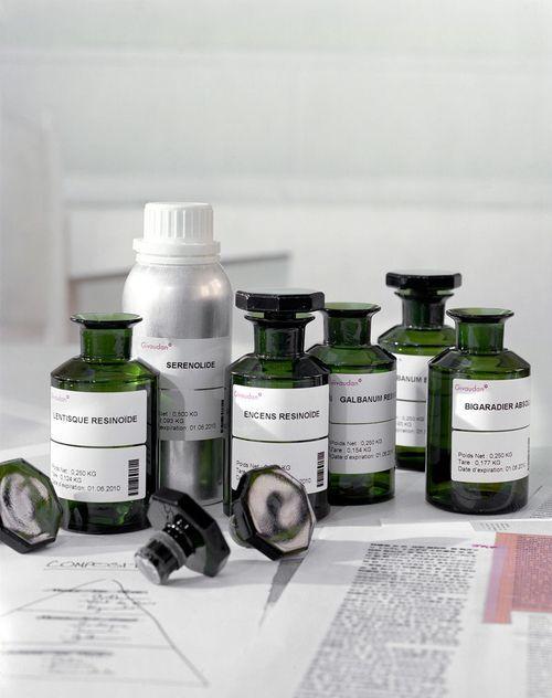 """Fragrance oil aromachemical bottles from Givaudan for Martin Margiela's """"Untitled"""" perfume. These bottle shapes inspired the final pkg."""