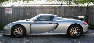 Porsche Carrera GT available here with silver gray color and $6000/day price.