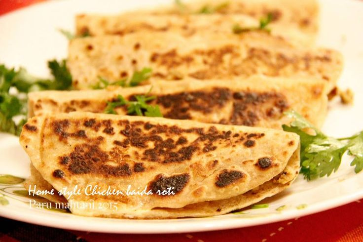 Home style Chicken Baida Roti…made with left over chicken kheema and left over chapatis.  Coat chapatis with a little egg, put a little kheema in the middle, fold over and cook on a tava with very little oil. Yummy quick snack….My fussy 12 year old wants to eat it every day!