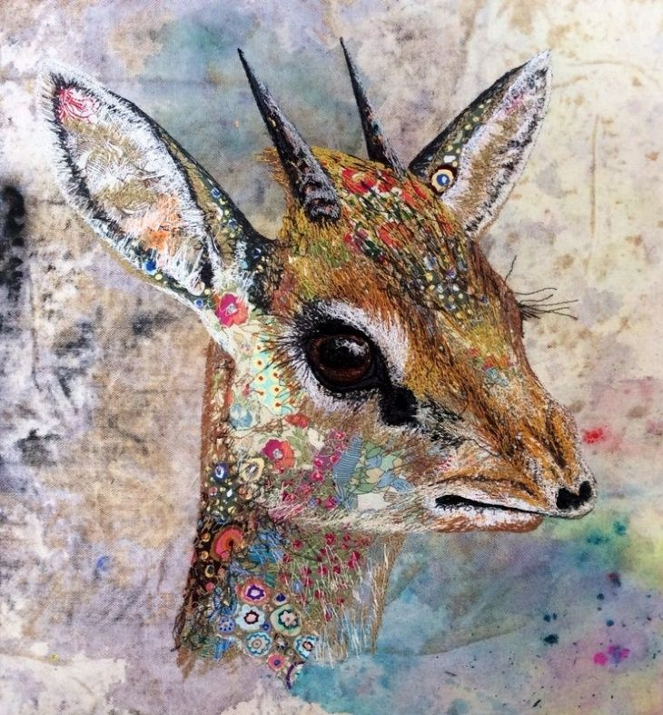 Elegant Embroidery Sophie Standing Art. LC: Can't find a translation button. Grrr. Looks like mixed media and I could stare at every animal for hours! Looks like a little eye in the fold of an ear on this creature. Wow!