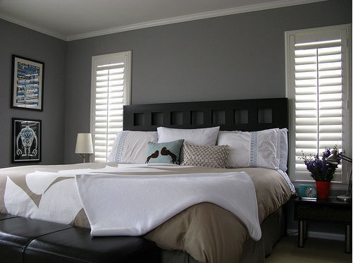 Kim's Relaxed Gray Bedroom | Apartment Therapy  Like the white wooden shutters against the grey wall