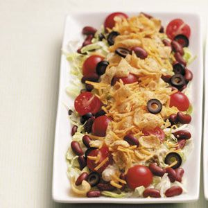 Meatless Taco Salad Recipe -This colorful salad from Kimberly Dray of Pflugerville, Texas blends together all your favorite taco ingredients...minus the ground beef. And you won't miss the meat at all! The guacamole dressing is thick and creamy.
