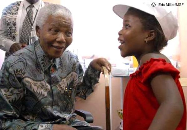 Nelson Mandela talking to an HIV-positive child
