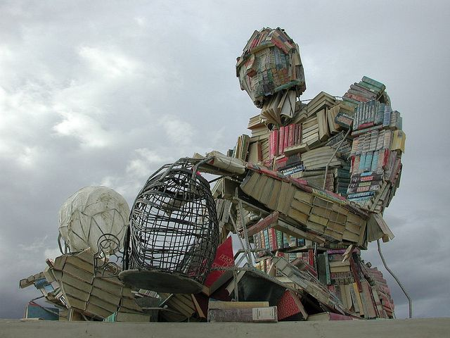 "BODY of KNOWLEDGE by Dana Albany (Book Sculptor) @ BURNING MAN 2000,  Black Rock Desert, northern NEVADA, USA ...  ""A large-scale sculpture of the human body, entirely composed of out-date textbooks and discarded library books"" ...  photo credit:  ""Scott Beale / Laughing Squid"""